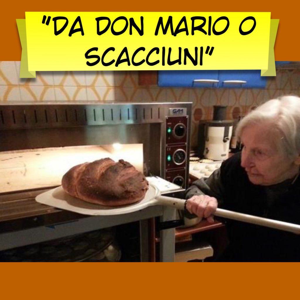 Nonnina che inforna il pane nel ristorante don mario